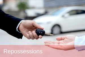 man handing over his car keys due to reposession