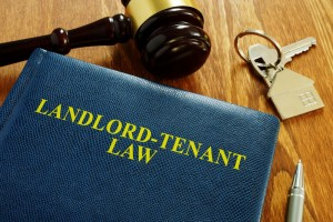 landlord tenant law book on a table