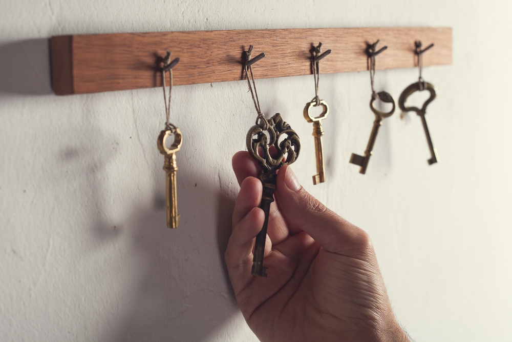 landlord choosing a property key after learning how to choose the best tenant for your rental