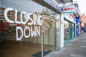 commercial tenant eviction in the UK, shop with a closed sign