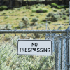 no-trespasser-sign-on-a-fence