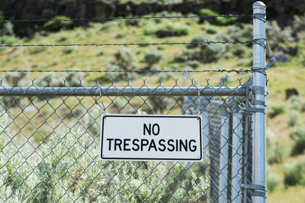 private land owner put up a no trespasser sign on a fence to deal with trespasser in the UK